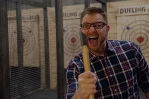 man at dueling axes